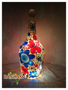This hand painted bottle features flowers in a mosaic style. Colorful Tiffany Lamp Mosaic Stained Glass Style Painted Bottle Light. This wine bottle / painted glass bottle has been hand painted and up-cycled to create a fun and functional art light accent lamp.  Website: http://www.randam-art.com  Facebook: http://www.facebook.com/RandamArt  Twitter: http://twitter.com/RandamArt