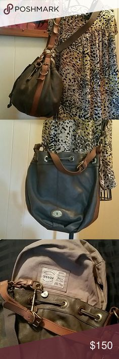 Fossil Maddox Leather Bucket Bag This is a vintage reissue maddox bag by Fossil. Authentic. Beautiful gray leather. Sturdy lining. Excellent Used Condition ECU. Brown leather shoulder strap, with brown leather continuing down each side to the bottom. Fabric gray crossbody strap that is removable and adjustable. Gorgeous brass or antique gold hardware. Appx 12x12. One large zipper compartment, and 2 slip pockets inside to help you stay organized. Large, roomy and versatile. Fossil Bags