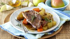 ONE-POT LAMB, VEGETABLE AND PEAR ROAST - This lamb pot with rosemary and garlic is ideal as a winter warmer served with steaming vegetables.