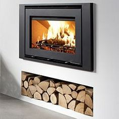 Insert stove with logs underneath - Wood Burning Fireplace Inserts Wood Storage, Home Fireplace, Wood Fireplace, Modern Stoves, Stove, Wood Burning Stove Insert, Fireplace, Wood Burning Fireplace Inserts