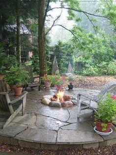 Yard hearth pit is central to a comfortable night.  See more at the picture