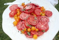Slice tomatoes and arrange on platter. If some tomatoes are very small, quarter and nestle within the slices. Lightly salt the tomatoes. In a small jar or container, combine juice of 1 lemon, Dijon mustard, salt and freshly ground black pepper. Shake to dissolve mustard and salt. Add 3x as much olive oil as there is lemon juice (for instance, if there was 1 tablespoon lemon juice, add 3 tablespoons oil). Shake to emulsify. Drizzle vinaigrette over tomatoes and scatter freshly torn Basil ...