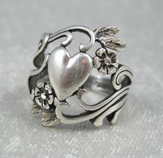 Vintage Art Nouveau Cast Sterling Ring Hearts and Flowers Signed OTT. ---via Etsy.