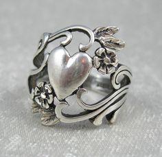 Vintage Art Nouveau Cast Sterling Ring Hearts and Flowers Signed OTT. ---via Etsy.