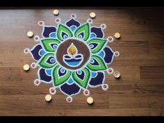 Here is a simple freehand rangoli design for Diwali. It is based on one of my original rangoli designs and I have tried to do some innovation with the placem. Rangoli Designs Simple Diwali, Simple Rangoli Border Designs, Rangoli Simple, Rangoli Designs Latest, Rangoli Designs Flower, Free Hand Rangoli Design, Small Rangoli Design, Rangoli Kolam Designs, Rangoli Ideas