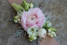 blush pink ranunculus wrist corage with ribbon