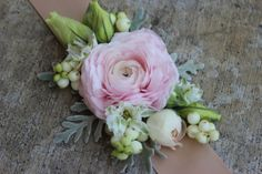 blush pink ranunculus wrist corage with ribbon