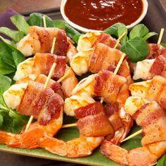 Shrimp en Brochette. Wrap shrimp in bacon with Monterey Jack cheese, jalapenos, and some Cajun seasoning.