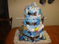 Homemade Diaper Cake Idea... This website is the Pinterest of diaper cake ideas