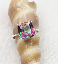 Just won this for  $24.00 LOVE IT! .925 Sterling Silver Rainbow Topaz Ring Sz 6. Tophatter.com!