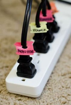 Genius!  Bread clips used to label cords on power strip found via Kari.