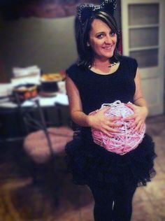 Kitty cat with a ball of yarn pregnant belly maternity costume for Halloween.