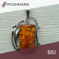 Baltic Amber and Sterling Silver Pendant Vintage sterling silver and baltic amber pendant. Very beautiful piece of amber. Stamped 925. Jewelry Necklaces