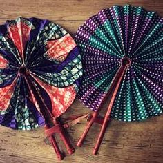 These colorful hand fans are our bestseller. Made out of leather and African print fabric they are a hot accessory for the Summer. Must have accessory! Hand Held Fan, Hand Fans, Interior Design Elements, Decor Interior Design, Ankara Bags, African Accessories, Ankara Designs, African Fabric, Fashion Fabric