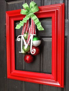 Christmas door decoration -- it'd be cute if there was something hanging that said merry christmas and had the ribbons and ornaments around it still