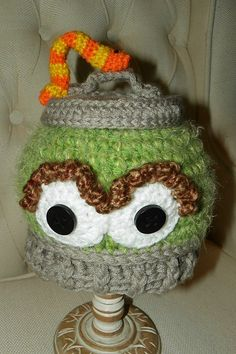 My Grouch in a Can with Slimy hat pattern is done :)  I love little Slimy!!