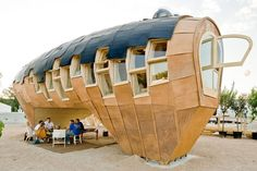 Pre Fab Eco Friendly Home- award winning plywood structure was designed by an international team of Architects in the image of a tree. The roof of the building is covered in solar paneling which collects the suns energy and stores in large battery units forming the foundations in the root of the dwelling. #plyman #plywood