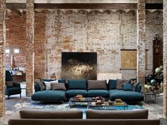 Rolf Benz Scala - Adepto  |  Wow, I love the teal sofa with the white washed brick walls...