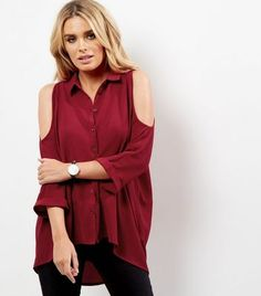 """Bring the cold shoulder trend into your everyday wardrobe this season. Try teaming with ripped knee jeans and boots to finish.- Collared neck- Button front fastening- Cold shoulders- Casual fit that is true to size- Longline design- Chloe is 5'8.5""""/174cm and wears UK 10/EU 38/US 6"""