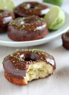 "bakeddd: "" lime cake doughnuts with chocolate glaze • click here for recipe """