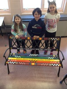 After a school wide coloring contest  Earthkeepers combined themes ( rainbow colors, smiley face, repeating patterns, school motto and welcoming message) to create their finished Buddy Bench design.