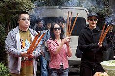 "Hong Kong director Pang Ho Cheung, Chinese actress Zhou Xun and actor Huang Xiaoming pray with joss sticks at the start-up ceremony for the filming of their new movie ""Everyone Loves Tender Women"" in Hong Kong, China, November 4, 2013"