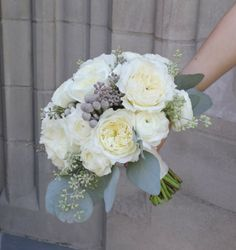 brides bouquet ivory garden roses and ranunculus by www.sweetpfloral.com