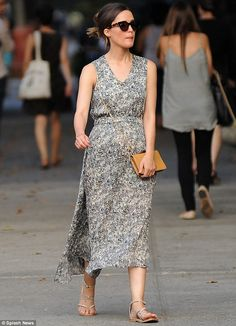 Summer rose: Embracing the heat in a floaty dress, that featured a swirling, multi-tonal p...