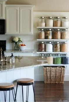 Build a big jar shelf to decorate with your beans, snacks and pasta. | 33 Clever Ways To Organize All The Small Things by Eva
