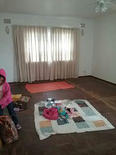 Lounge. Found beautiful parquet flooring under the carpets.