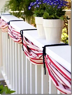 Yards of red and white material tied with blue yarn for a patriotic bunting.