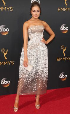 2016 Emmys: Olivia Culpo is wearing a white Zac Posen strapless midi dress. The white dot detailing reminds me of snow. Beautiful dress!