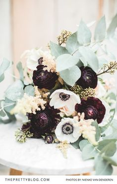 Muted Green and Dark Purple Floral Bouquet | Photography by Nienke van Denderen | Flowers by Judith Slagter