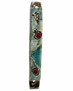 Blue Ceramic Mezuzah with Red Pomegranates and Brown Shin by World of Judaica. $38.00. This blue Ceramic Mezuzah has a brown Hebrew letter Shin near the top that sits above two red pomegranates that in the middle and bottom on both sides of a small dark blue triangle.