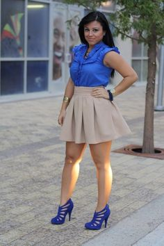 if you are larger on bottom, your legs are the better half of you. by picking an A line skirt with pleats, you'll draw the attention away from your bottom and on to those fine legs.