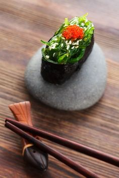 seaweed sushi with rice underneath (*replace fish eggs with crushed carrots)