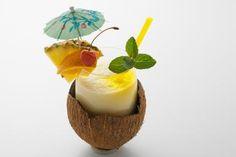 Virgin Pina Colada Recipe: A Favorite No-Booze Drink From the Islands Virgin Pina Colada, Easy Desserts, Dessert Recipes, Drink Recipes, Coconut Shell, Coconut Syrup, Fun Drinks, Booze Drink, Smoothie Recipes