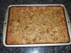 Pan of baked cornbread dressing...I added ground sausage with the gizzards and I added some toast. It was bland so I added some salt, I also used buttermilk for the cornbread. Easy to follow, but I'll probably try another recipe, this wasn't my favorite.
