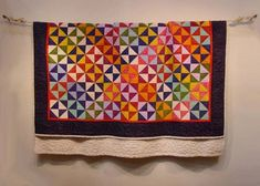 """It may be hard to believe, but this quilt is actually carved out of wood! """"Fiestaware"""" by Fraser Smith. Carved wood & Watercolor 60"""" x 42"""" x 4"""" 2000"""