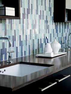 Bathroom above sink, under cabinet. Using+thinner+glass+tile+vertically+gives+the+impression+of+movement.+Here+the+muted+blues+create+a+waterfall+effect+above+the+vanity.+Dark+countertops+reflect+the+tile+and+help+the+color+spill+over+the+edge. Bathroom Tile Designs, Bathroom Renos, Budget Bathroom, Bathroom Colors, Master Bathroom, Bathroom Ideas, Bathroom Wall, Bathroom Updates, Mosaic Bathroom