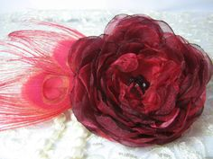 A flower in the hair or as an accent piece? Burgundy red fabric flower with red peacock by PaijasBoutique, $34.00