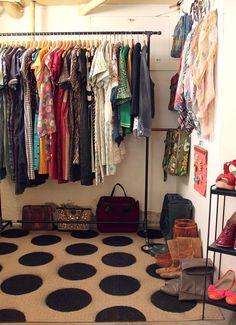 Makeshift closet in a basement! I love the garmet rack idea to make the laundry room more versatile!