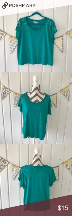"""Company Ellen Tracy Teal Studded Tee Shirt This is a gorgeous teal colored short sleeve tee by Ellen Tracy. It features rolled up short sleeves with tiny silver studs on them. The top is in very good condition. Almost perfect, but there is a tiny pick like spot, on the front (see last picture). The spot is not noticeable while wearing.  Approximately 23.5"""" long Ellen Tracy Tops Tees - Short Sleeve"""