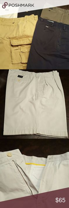 Men's Nautica Shorts sz 40 EUC 5 pairs of shorts from Nautica. Sz 40 waist.  9 in inseam.  All Gently worn. Professionally cleaned and pressed, ready to wear! 4 pairs are in style of pic 2 with button pleated front and zipper. 2 back pockets. 1 pair  of khaki is cargo style. Pic 4, olive color has a couple minor spots that are barely noticeable where the color has lightened.  Colors are: khaki, black, olive, tan and navy. Nautica Shorts
