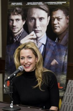 A ROSE AMONG THE... Anderson at an overseas press conference for 'Hannibal,' with co-stars Hugh Dancy, Mads Mikkelsen and Laurence Fishburne virtually behind her