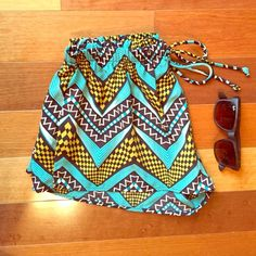 """SALE⬇️ 🐠flowy print shorts🐠 •Black, teal, white, & yellow chevron/check/tribal print flowy shorts •NWT Retail •100% polyester •Made in USA •Elastic banded waist, faux tie drawstring •Super easy summer staple piece •Fits true to size •Length from the waistband down to hemline is 10"""" in the front & 12"""" in the back •No trades •Price is firm unless bundled •I ship same day/next day! 📫📦 Boutique Shorts"""