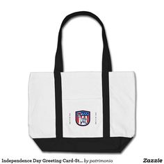 "Independence Day Greeting Card-Statue of Liberty W. Tote bag featuring an illustration of the Statue of Liberty holding a flaming torch and a stars and stripes shield set inside a crest done in retro style with the words ""Happy Independence Day."