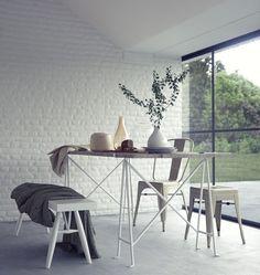 une salle de séjour blanche et élégante avec un mur en briques de parement blanches