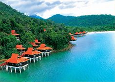 An amazing island off the coasts of Malaysia and Thailand. If you visit, stay in a bungalow on the beach! -Lankawi Island, Malaysia