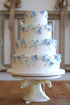 Tiered wedding cake with blue flowers